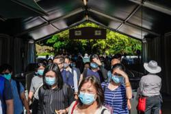 Hong Kong reports surge in local Covid-19 infections