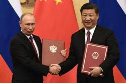 Xi: China to continue working with Russia and reject intervention