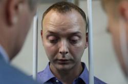 Russian journalists fear growing media persecution after treason arrest