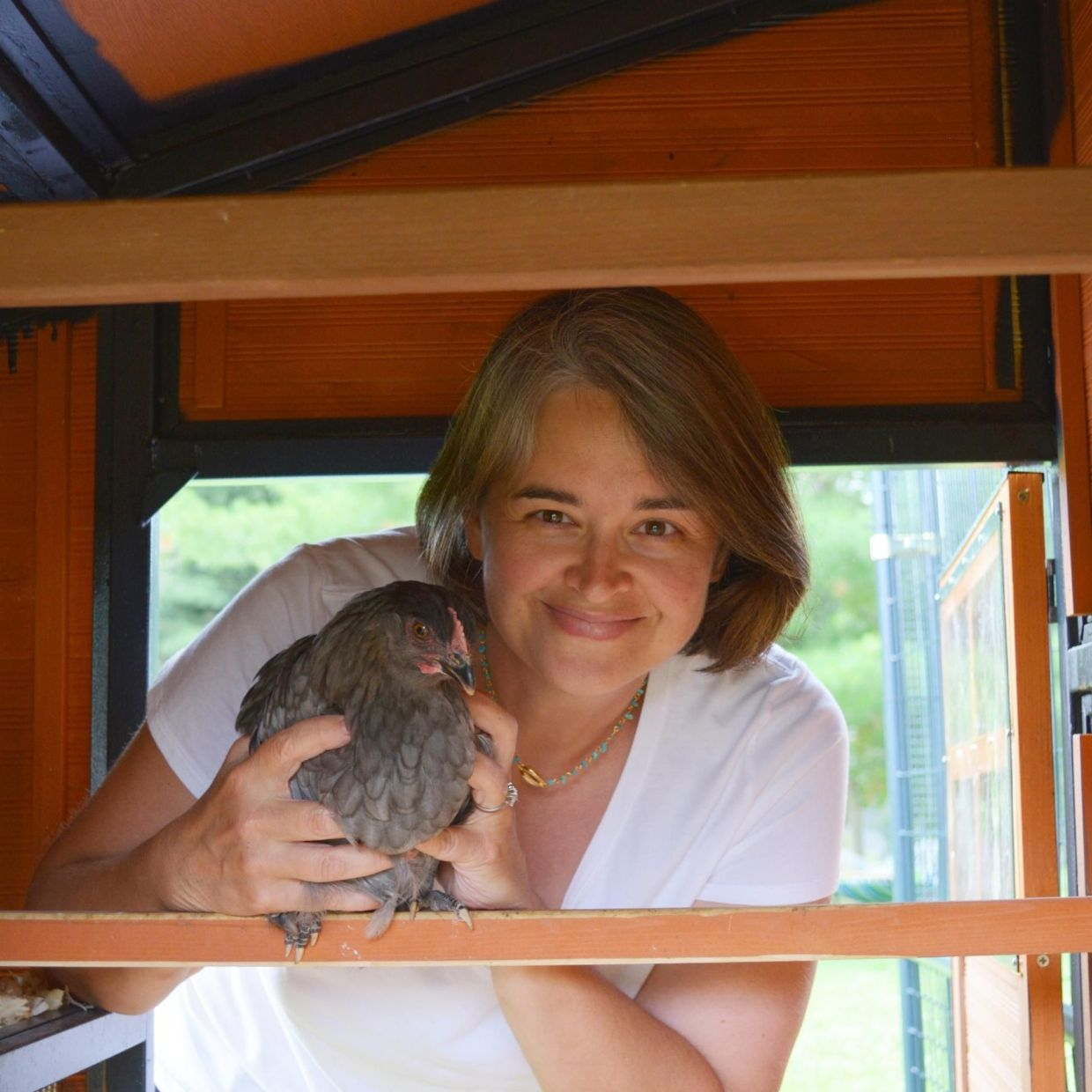 Amy Smith with her chicken Daisy, a Blue Copper Maran.