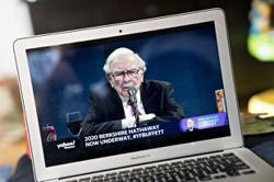 Buffett dropping down world's richest ranks as tech titans surge