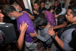 Six, including politician, charged in fatal kidnapping case of Datuk Seri