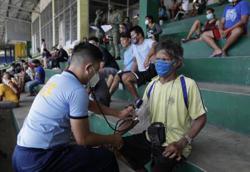 Philippines virus cases soar past 50,000 as lockdown eases