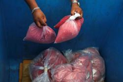 Cops seize RM55k worth of drugs after raiding Cheras courier company