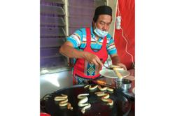 Fangtastic: Seller cooks up snake-shaped roti canai