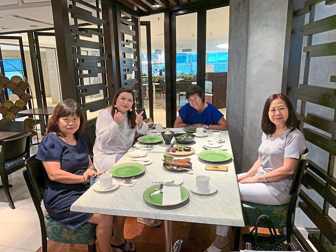 Wong (seated left in blue) enjoyed her experience eating out but says she will only dine out for important occasions now, as she doesn't want to go out too much. — MELANIE WONG