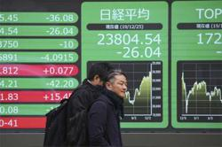 Asian shares set to slip Friday as coronavirus concerns weigh