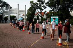 Singapore polls: Long queues at polling stations, younger voters told to stick to time slots