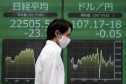 Asian stocks sink after Wall St losses on economy worries