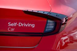 Long road ahead for fully self-driving cars, despite Tesla claim
