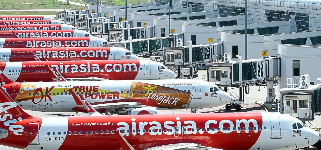 Positive outlook: AirAsia aircraft sit idle on the tarmac of KLIA2. The airline is confident its business will continue to survive, given the efforts already undertaken to raise cash and to cut costs, more importantly to see its cash expenses drop by 50% this year.