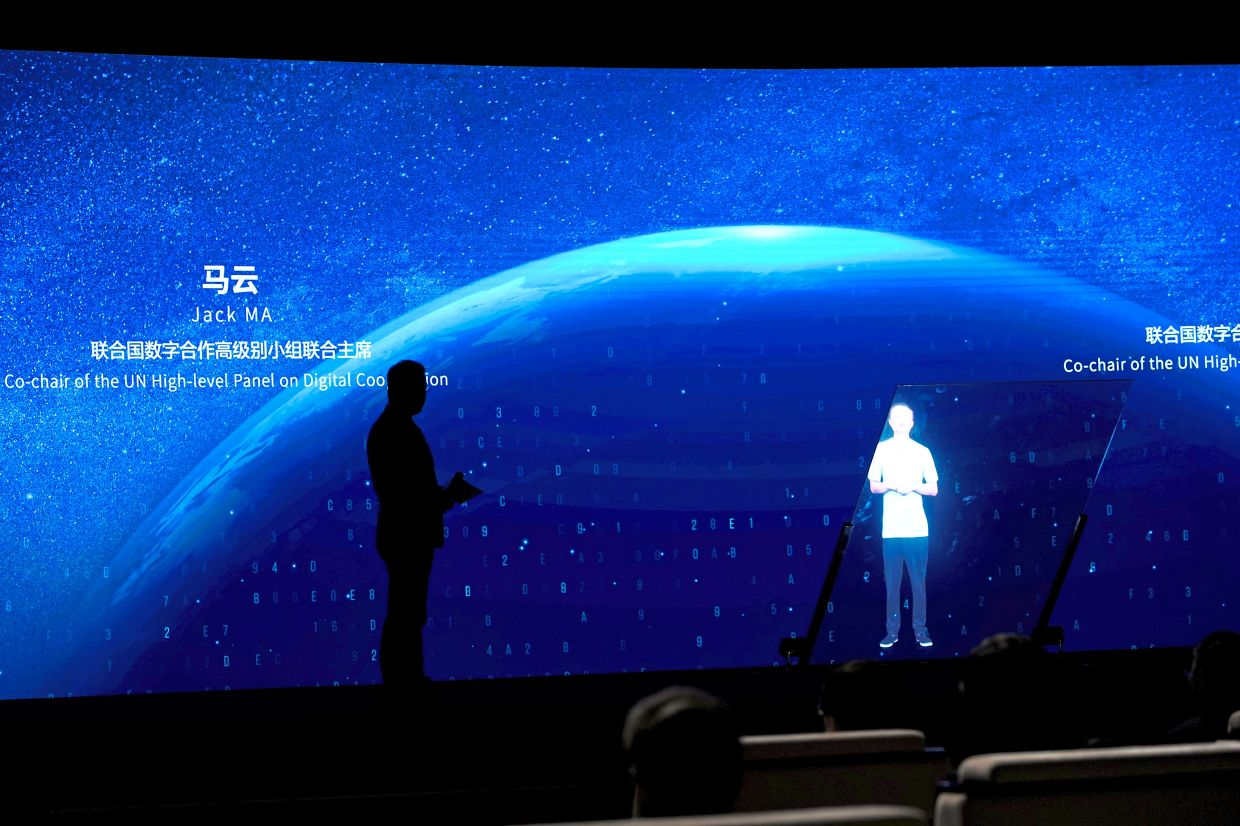 Hi-tech conference: Jack Ma, Alibaba's founder and former chairman, is seen during a video message at the opening ceremony of the World Artificial Intelligence Conference in Shanghai on Thursday. Alibaba Group's market capitalisation has edged slightly above Facebook Inc. — Reuters