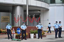 Hong Kong police search pollster's office days after security law introduced