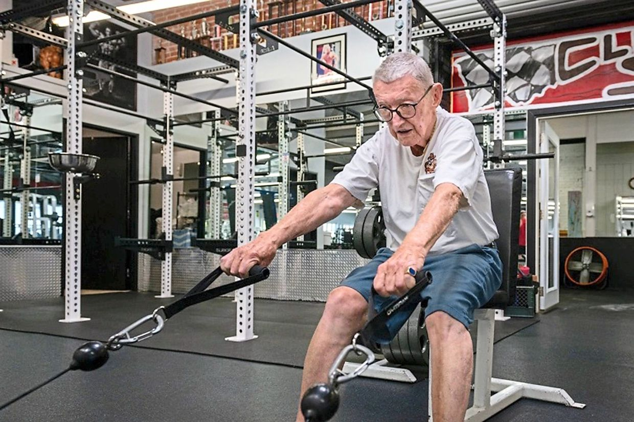 Art Ballard performs seated cable pulls during his total body workout at the gym. 'I try to get my heart rate up to 140, ' he says.