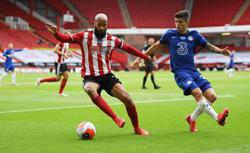 Chelsea's Champions League hopes hit by McGoldrick double for Blades