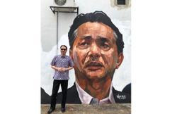 Health DG checks out his own mural portrait