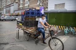 Poll: China economy rebounds in Q2 after virus hit