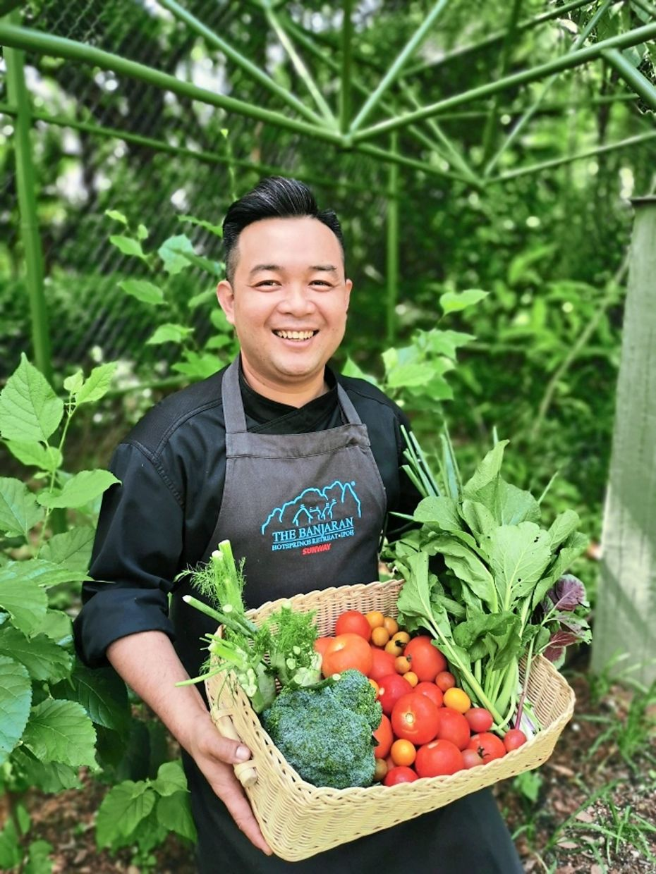 The resort's head chef, Lee with fresh produce from the organic garden.