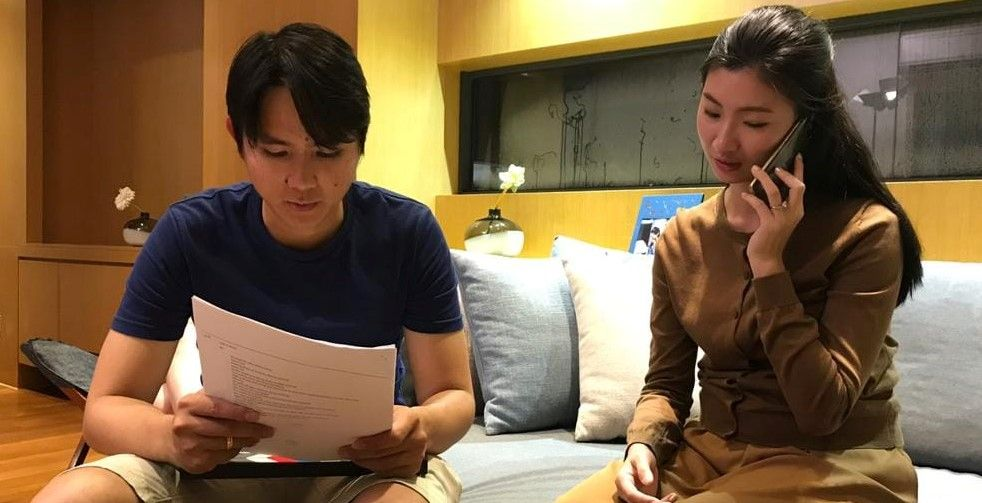 Anthony Tham with a cast member on the set of 'One Day'.