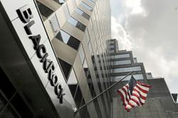 Investors await BlackRock earnings to gauge industry