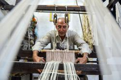 Workshop to museum: Syrian farmer celebrates dying ancient silk craft