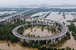 China: 33 rivers hit record levels as floods situation remains 'grim'; 141 dead or missing