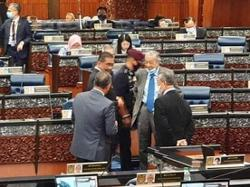 Dr M and Muhyiddin seen chatting in Parliament on Monday (July 13)