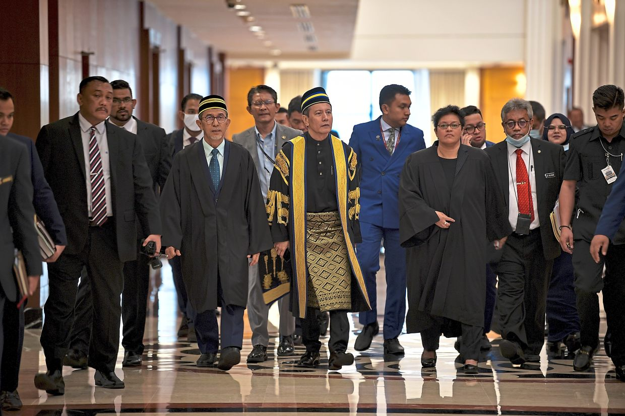 In the news: Azhar (centre) and Pengerang Member of Parliament, Azalina (second from right) making their way into the Dewan Rakyat. — Bernama