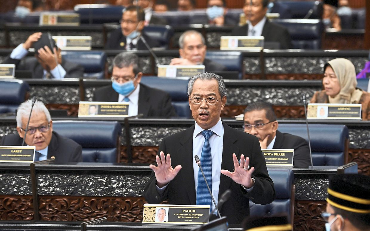 Taking the floor: Muhyiddin speaking during a question-and-answer session at the Dewan Rakyat. — Bernama