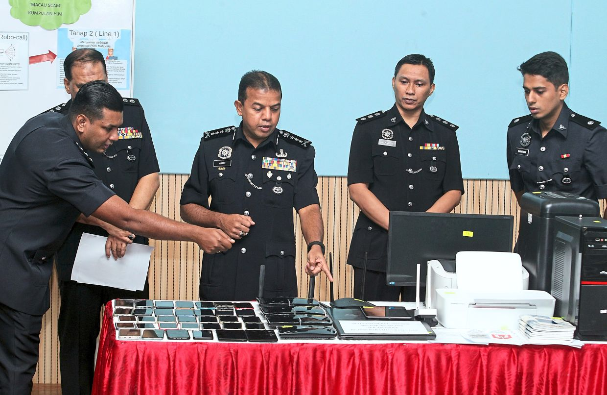 Large haul: Comm Ayob (centre) showing the seized items during a press conference held at the state police headquarters.