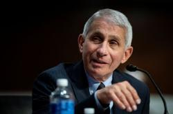 Fauci blames virus surge on U.S. not shutting down completely