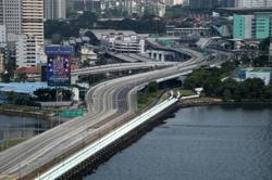 Malaysia and Singapore set up commuting arrangements for pass holders, green lane for business travellers