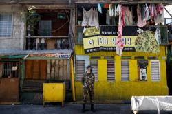 Philippines to use police in house-to-house searches for COVID-19 cases