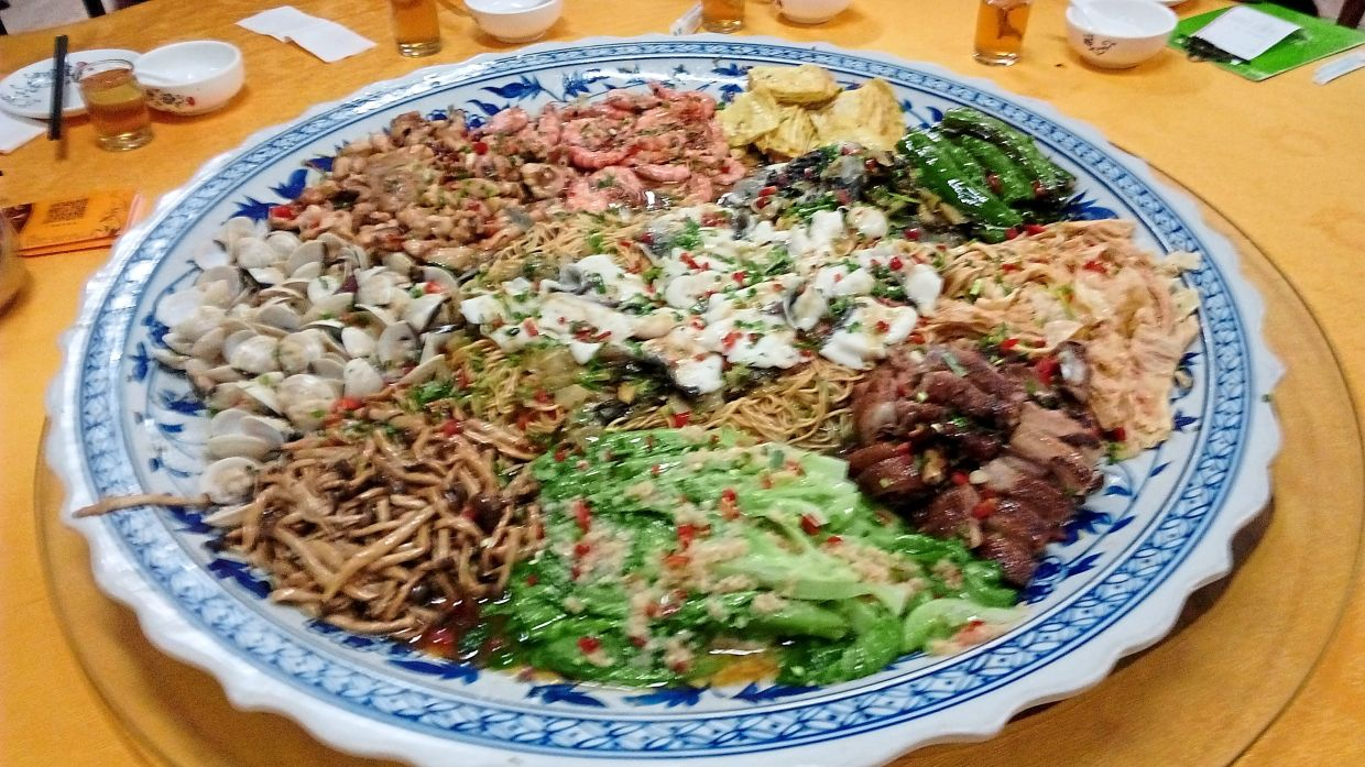 Poon choi contains more than 10 different types of dishes served on a giant platter.