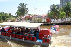 Go on a river cruise in Malaysia