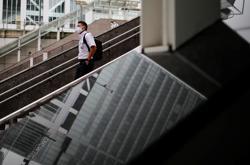 Tokyo to lift coronavirus alert to highest level - Asahi