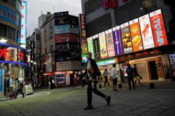 Tokyo may raise Covid-19 alert as tourism campaign comes under fire
