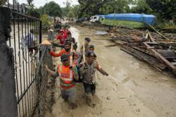 Rescuers looking for 23 missing in deadly Indonesia floods