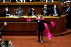 Pink-caped Chilean deputy brings lawmakers to their feet to celebrate coronavirus bill