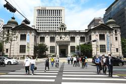 South Korea central bank holds rates at record low