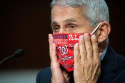 U.S. state, local leaders should be as forceful as possible on masks -Fauci