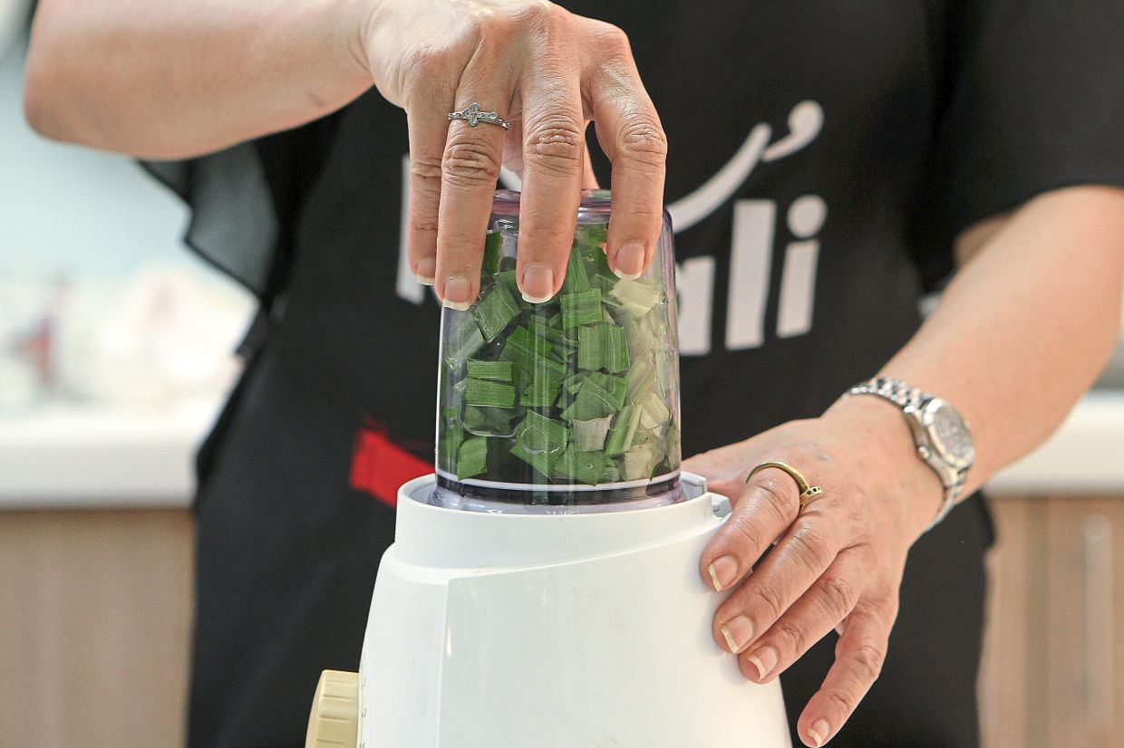 Blend the pandan leaves with water to extract the juice.
