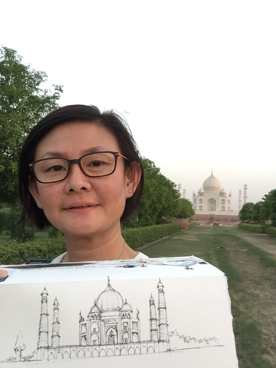 Teo-Simpson and her sketch of the Taj Mahal in Agra, India.