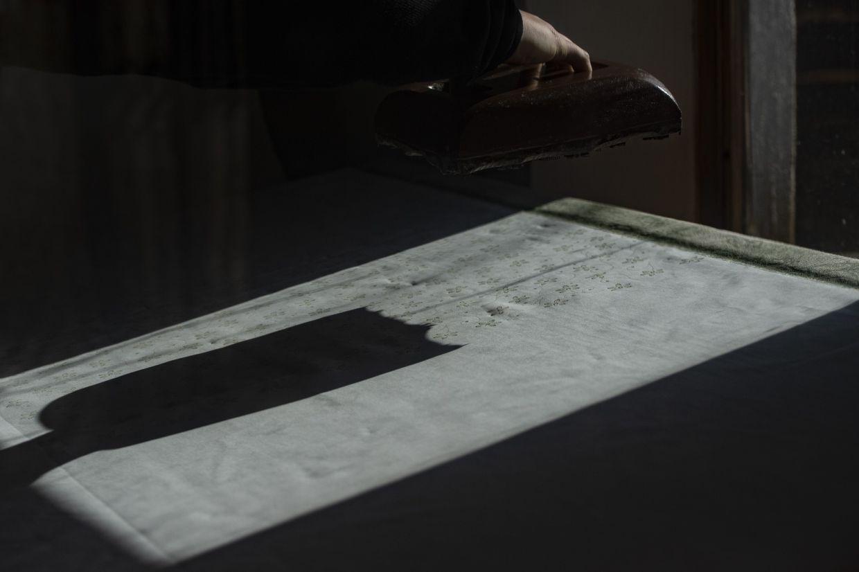 Danzinger prints with wax on a textile at his blueprint workshop. Photo: AFP
