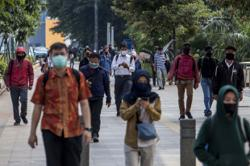Indonesia's virus cases, deaths accelerate after reopening