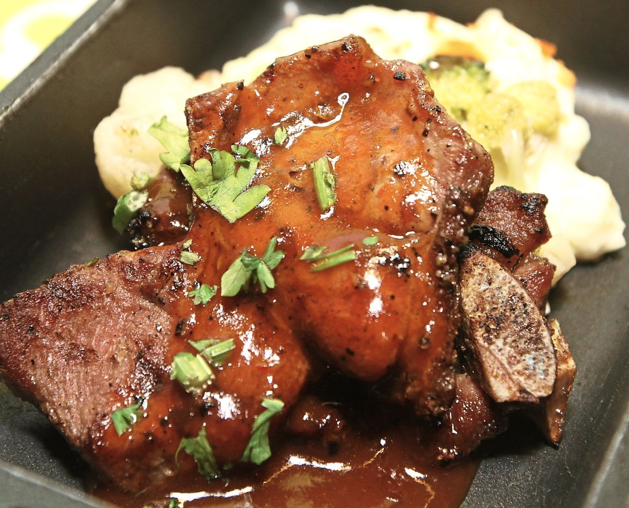 Lamb Slice with Garlic Mashed Potato with a choice of barbeque and mushroom sauce.