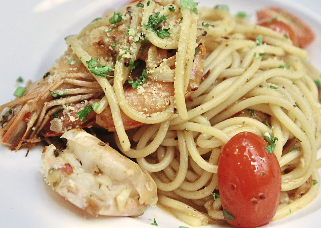 The Pasta Aglio Olio with Prawns is  flavourful.