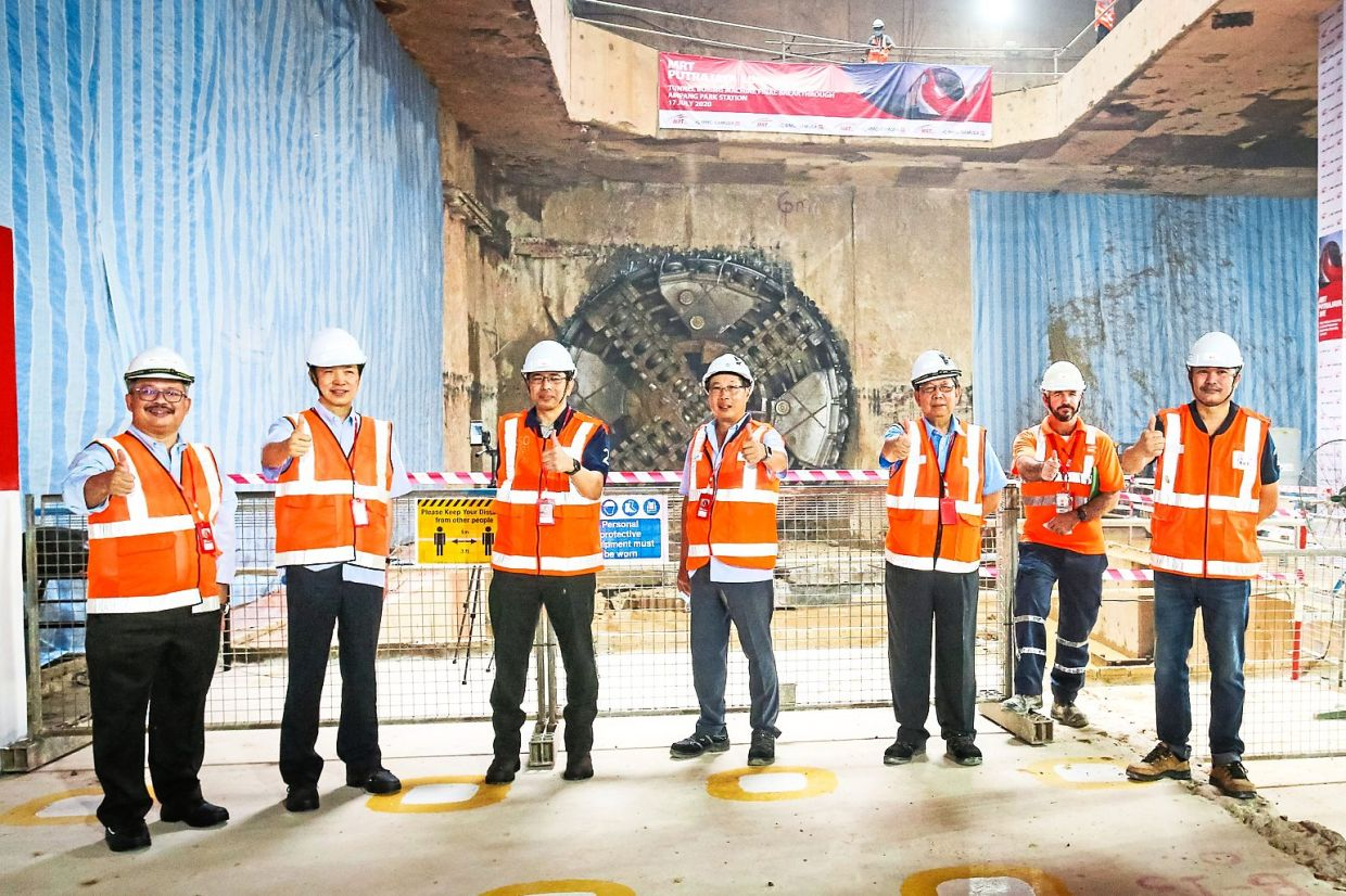 Senior management heads from MMC Gamuda and MRT Corp at the spot where the S-774 tunnel boring machine broke through.