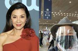 Michelle Yeoh dons mask, goggles and face shield on Paris-Sydney flight