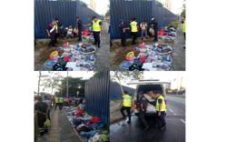 Foreign construction workers nabbed for illegally selling used clothes